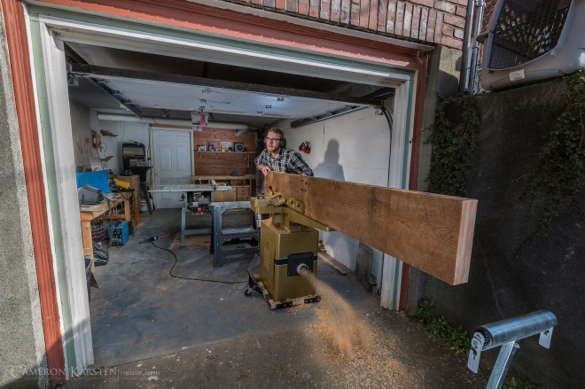 Casey Zautke of Barn Owl Builds prepares a beam of fir for a conference table
