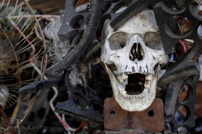 "A sculpture by André Eugène. All of the skulls in his work are real human skulls. I asked him how he was able to get a hold of the skulls and he said, ""Many things are easy to come by in Haiti. All my work is recycled. You ask for a human skull, you can easily get one."""