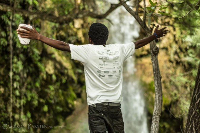 A young man prays before the waterfalls of Saut d'Eau in the Artibonite Valley.