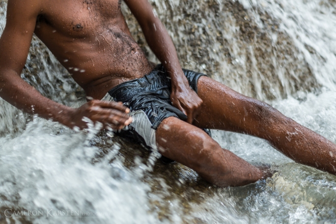 A pilgrim cleanses and scrubs himself of his sins in the waters of Saut d'Eau.