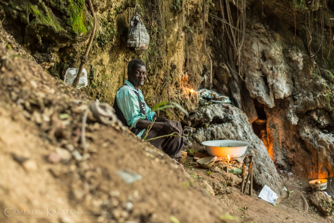A man sells candles for pilgrims at the waterfalls of Saut d'Eau.