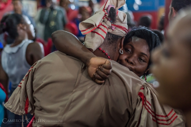 Two congregation members in trance embrace at a hounfour in Montagne Noire, Port-au-Prince.