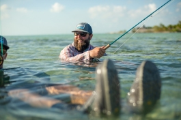 © Cameron Karsten Photography with Sage in Belize fly flishing for bonefish
