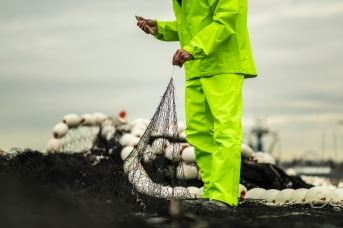 © Cameron Karsten Photography photographs Grundens' new bibs and jacket on the Silver Wave in Seattle, WA